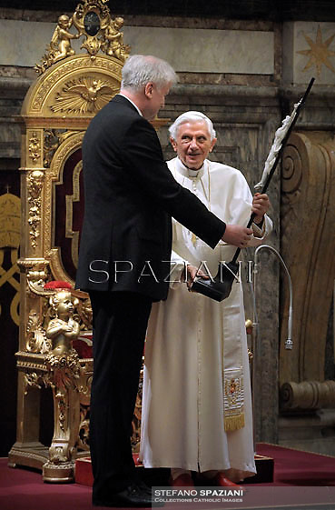 Pope Beneditct XVI receigving a present from Bavaria's President Horst Seehofer on the occasion of Pontiff's 85th birthday celebrations in the Clementine hall at the Vatican on April 16, 2012. Pope Benedict XVI celebrated his 85th birthday Monday with visitors from his native state of Bavaria in Germany and is now the oldest pope since Leo XIII, who died in 1903 aged 93.