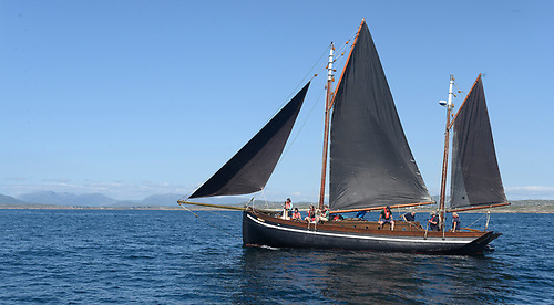 The musicians are on the Galway hooker Mac Duach, skippered and owned by Dr Michael Brogan