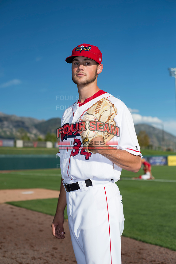 Orem Owlz pitcher Cole Duensing (34) poses for a photo prior to a Pioneer League game against the Ogden Raptors at the Home of the OWLZ on August 24, 2018 in Orem, Utah. The Ogden Raptors defeated the Orem Owlz by a score of 13-5. (Zachary Lucy/Four Seam Images)