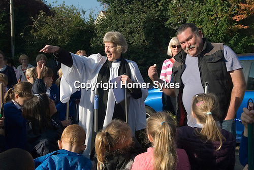 Old Mans Day Braughing Hertfordshire October 2nd. 2015. Mark Landon with the one pound coin he will pay to the vicar the Rev'd Julie Gawthrope for sweeping Fleece Lane.