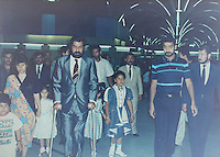 Baghdad, Iraq, Saddam's family pictures, date unknown..Saddam's half brother, left, with the crutches, and Oudai, right, in Saddam International Airport..This photo was taken shortly after Watban allegedly lost his left leg after Oudai shot him during a family argument...