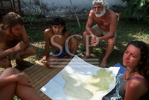 Chapada dos Guimaraes, Mato Grosso, Brazil. Ed Posey, Liz Hosken, Mario Friedlander and Jorge with a map of brazil; 1990.