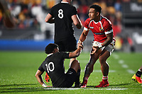 3rd July 2021, Auckland, New Zealand;  Richie Mo'unga (L) is helped up by Sonatane Takulua.<br /> New Zealand All Blacks versus Tonga, Steinlager Series, international rugby union test match. Mt Smart Stadium, Auckland. New Zealand.