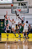 12 March 2019: University of Vermont Catamount Forward Samuel Dingba, a Redshirt Senior from Yaounde, Cameroon, defends a shot by Binghamton University Bearcat Guard Timmy Rose, a Senior from Scranton, PA, at Patrick Gymnasium in Burlington, Vermont. The top-seeded Catamounts advanced to their fourth-straight America East conference championship game, defeating the Bearcats 84-51. Mandatory Credit: Ed Wolfstein Photo *** RAW (NEF) Image File Available ***