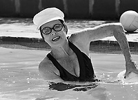 Actress Bette Davis in Pool, Los Angeles, 1977. Photo by John G. Zimmerman.