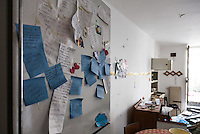 Inside the Red Zone, cordoning off the medieval center of L'Aquila. The interiors of the houses, fled on a deadly night of six years ago, still show the signs of an abruptly interrupted life. In a students house roommates post it notes still hang on the fridge. L'Aquila, Italy. Apr. 10, 2015