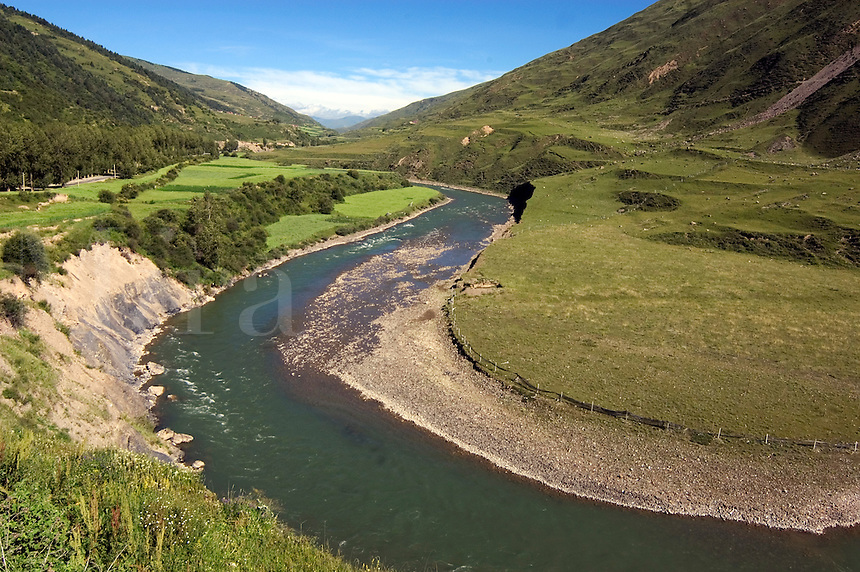 A river valley with high altitude barley fields (tsampa) in summer - Kham (Eastern Tibet), Sichuan Province, China