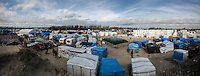 "Calais Jungle Camp (On the right) the containers' ""new camp"" protected by high fences, security guards and finger prints reader at the gate used as the ""key"" to enter.<br />