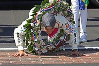 30th May 2021, Indianapolis, Indiana, USA; NTT Indy Car Series driver Helio Castroneves kisses the bricks after winning the 105th running of the Indianapolis 500 on May 30, 2021 at the Indianapolis Motor Speedway in Indianapolis, Indiana.