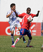 Gerardo Iraheta (17) of El Salvador tries to take the ball away from Jake Beckford (7) during the group stage of the CONCACAF Men's Under 17 Championship at Jarrett Park in Montego Bay, Jamaica. Costa Rica defeated El Salvador, 3-2.