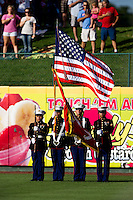 Members of the Marines present the colors prior to a game between the Corpus Christi Hooks and the Springfield Cardinals at Hammons Field on August 13, 2011 in Springfield, Missouri. Springfield defeated Corpus Christi 8-7. (David Welker / Four Seam Images)
