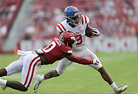 Arkansas defensive back Jerry Jacobs (0) grabs a hold of Ole Miss running back Jerrion Ealy (9), Saturday, October 17, 2020 during the third quarter of a football game at Donald W. Reynolds Razorback Stadium in Fayetteville. Check out nwaonline.com/201018Daily/ for today's photo gallery. <br /> (NWA Democrat-Gazette/Charlie Kaijo)
