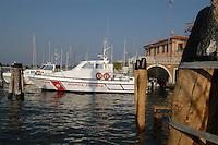 - motovedetta della Guardia Costiera ormeggiata in un canale di Chioggia, città lagunare a sud di Venezia)....- patrol motorboat of the coastgard  moored in a channel of Chioggia, lagoon city south of Venice ( Italy ) Italia