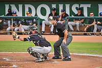 Matt Jones (16) of the Missoula Osprey and home plate umpire Isaias Barba behind the plate during the Pioneer League game between the Ogden Raptors and the Missoula Osprey at Lindquist Field on July 20, 2015 in Ogden, Utah. Missoula defeated Ogden 10-6. (Stephen Smith/Four Seam Images)
