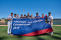 The Salt River Rafters coaching and trainers staff celebrate after winning the Arizona Fall League Championship Game against the Surprise Saguaros on October 26, 2019 at Salt River Fields at Talking Stick in Scottsdale, Arizona. The Rafters defeated the Saguaros 5-1. (Zachary Lucy/Four Seam Images)