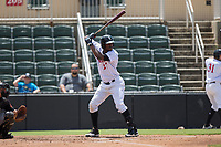 Micker Adolfo (27) of the Kannapolis Intimidators at bat against the West Virginia Power at Kannapolis Intimidators Stadium on June 18, 2017 in Kannapolis, North Carolina.  The Intimidators defeated the Power 5-3 to win the South Atlantic League Northern Division first half title.  It is the first trip to the playoffs for the Intimidators since 2009.  (Brian Westerholt/Four Seam Images)