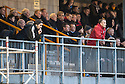 Alloa manager Paul Hartley and Ayr Utd manager Mark Roberts watch from the stand.