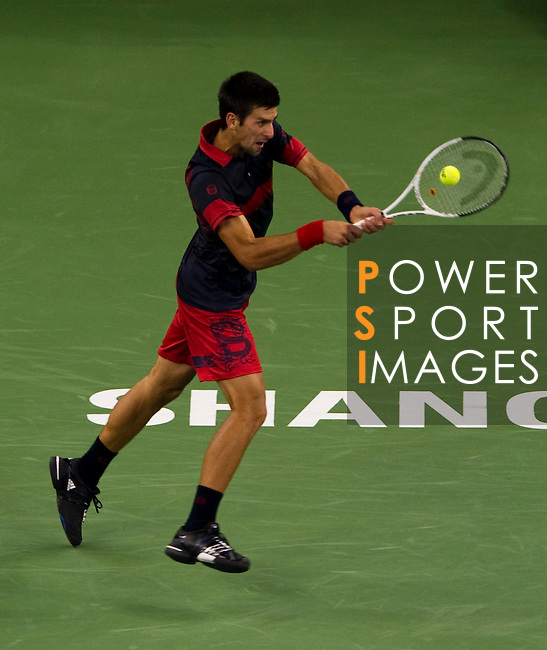 SHANGHAI, CHINA - OCTOBER 13:  Novak Djokovic of Serbia returns a ball to Ivan Ljubicic of Croatia during day three of the 2010 Shanghai Rolex Masters at the Shanghai Qi Zhong Tennis Center on October 13, 2010 in Shanghai, China.  (Photo by Victor Fraile/The Power of Sport Images) *** Local Caption *** Novak Djokovic
