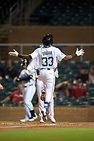 Salt River Rafters Vidal Brujan (33), of the Tampa Bay Rays organization, celebrates as he crosses home plate after hitting a home run during an Arizona Fall League game against the Mesa Solar Sox on September 19, 2019 at Salt River Fields at Talking Stick in Scottsdale, Arizona. Salt River defeated Mesa 4-1. (Zachary Lucy/Four Seam Images)