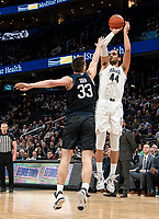 WASHINGTON, DC - JANUARY 28: Omer Yurtseven #44 of Georgetown shoots over Bryce Golden #33 of Butler during a game between Butler and Georgetown at Capital One Arena on January 28, 2020 in Washington, DC.