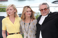 KIRSTEN DUNST, VANESSA PARADIS AND PRESIDENT OF THE JURY GEORGE MILLER - PHOTOCALL OF THE JURY AT THE 69TH FESTIVAL OF CANNES 2016