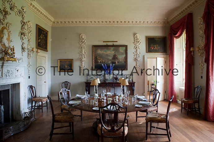 The dining room was created in the 1950s and makes use of decorative plasterwork and carving by Grinling Gibbons that came from the original ballroom
