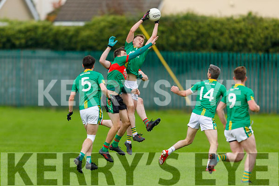 Castlegregory Séamus Ó Gráda fields the ball under pressure from Phillie Blake and Neilus Mulvihill of Beale in the Junior Football Championship semi final.