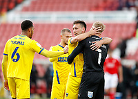 10th October 2020; The County Ground, Swindon, Wiltshire, England; English Football League One; Swindon Town versus AFC Wimbledon; Luke O'Neill of AFC Wimbledon celebrates after the final whistle with Goalkeeper Connal Trueman and Terell Thomas of AFC Wimbledon
