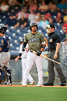Nashville Sounds shortstop Franklin Barreto (9) at bat in front of home plate umpire Junior Valentine during a game against the New Orleans Baby Cakes on April 30, 2017 at First Tennessee Park in Nashville, Tennessee.  The game was postponed due to inclement weather in the fourth inning.  (Mike Janes/Four Seam Images)