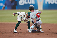Greensboro Grasshoppers shortstop Francisco Acuna (7) applies a tag to Garrison Schwartz (46) of the Rome Braves as he attempts to steal second base at First National Bank Field on May 16, 2021 in Greensboro, North Carolina. (Brian Westerholt/Four Seam Images)
