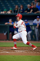Memphis Redbirds right fielder Todd Cunningham (15) follows through on a swing during a game against the Round Rock Express on April 28, 2017 at AutoZone Park in Memphis, Tennessee.  Memphis defeated Round Rock 9-1.  (Mike Janes/Four Seam Images)
