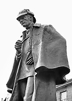 BNPS.co.uk (01202 558833)<br /> Pic: TheHistoryPress/BNPS<br /> <br /> Sherlock Holmes statue in Picardy Place, Edinburgh, close to the site of his author's birth.<br /> <br /> Sir Arthur Conan Doyle's custom-made portable desk has emerged for sale for £96,000 - and it is as intricate as one of his Sherlock Holmes' plots.<br /> <br /> On first glance it appears to be a standard leather trunk, before folding out to reveal a wooden desk and a bookcase.<br /> <br /> Conan Doyle, a keen traveller, wanted to be able to continue to write wherever he found himself day to day.<br /> <br /> The desk was devised by the French goods maker Goyard for the prolific author in 1925.<br /> <br /> It is being sold by furniture dealer Timothy Oulton, who has a gallery in Chelsea, west London.