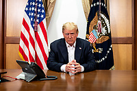 OCT 04 Trump Poses for a Photo as he Participates in a Phone Call