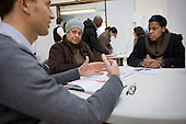 Local residents speak to an Environmental Health Officer at a regular Monday afternoon drop-in advice session at the Beethoven Centre, Queen's Park.