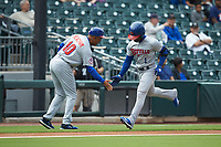 Buffalo Bisons manager Bobby Meacham (10) slaps hands with Jonathan Davis (1) as he rounds third base after hitting a home run against the Caballeros de Charlotte at BB&T BallPark on July 23, 2019 in Charlotte, North Carolina. The Bisons defeated the Caballeros 8-1. (Brian Westerholt/Four Seam Images)