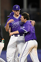 Closer Tyler Kimbrell (35) of the Furman Paladins hugs starting pitcher Matt Lazzaro, right, after finishing game two of a doubleheader against the Harvard Crimson on Friday, March 16, 2018, at Latham Baseball Stadium on the Furman University campus in Greenville, South Carolina. Furman won, 7-6. (Tom Priddy/Four Seam Images)