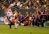 Danny O'Rourke NY Red Bulls Mid. keeps Chivas USA Mid. Francisco Mendoza at bay while his bench looks on during a 0-0 tie between the Chivas USA vs New York Red Bulls in a game at The Depot Center in Carson, California Saturday, April, 29, 2006.