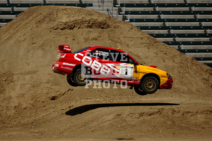 Driver Patrick Richard and co-driver Nathalie Richard get some air while competing in the Rally Car Race finals during X-Games 12 in Los Angeles, California on August 5, 2006.