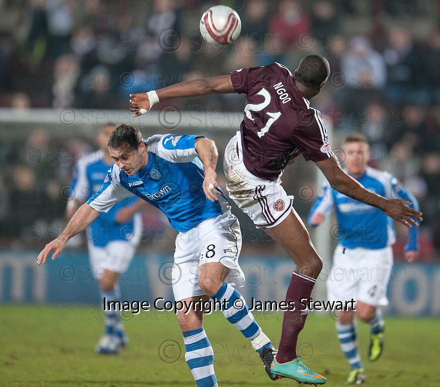 St Johnstone's Murray Davidson and Hearts' Michael Ngoo  challenge for the ball.