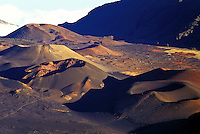 Moon-like cinder cones composed of red sand inside the crater at Haleakala National Park on Maui.