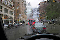 USA, Oregon, Watching through rainy car window at downtown Portland traffic