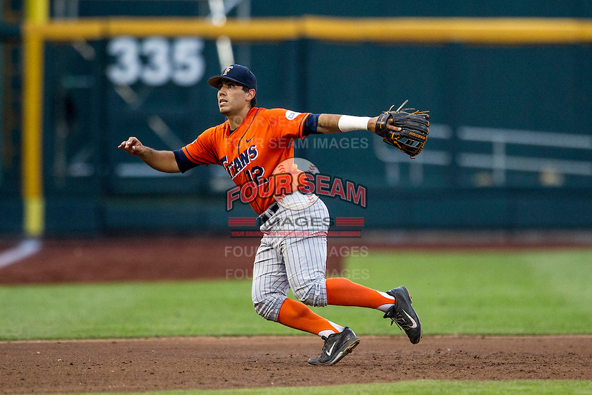 Cal State Fullerton Titans third baseman Jerrod Bravo (12) on defense during the NCAA College baseball World Series against the Vanderbilt Commodores on June 14, 2015 at TD Ameritrade Park in Omaha, Nebraska. The Titans were leading 3-0 in the bottom of the sixth inning when the game was suspended by rain. (Andrew Woolley/Four Seam Images)