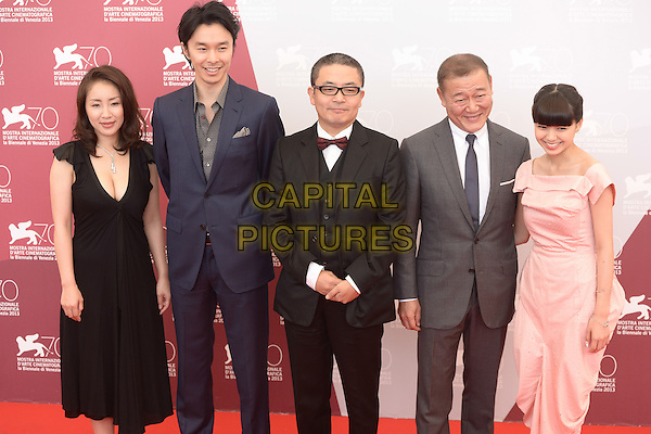Actors Megumi Kagurazaka, Hiromi Hasegawa, Director Sion Sono, actors Jun Kunimura and Fumi Nikaido <br /> The 'Why Don't You Play In Hell?' (Jigoku de naze warui) photocall during the 70th Venice International Film Festival at Palazzo del Casino, Venice, Italy. <br /> August 29th, 2013<br /> half length black dress cleavage blue suit grey gray pink glasses 3/4<br /> CAP/ZZG<br /> ©ZZG/Capital Pictures