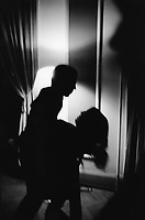 Switzerland. Canton Ticino. Locarno. Party at the Grand Hotel for the last night of International Filmfestival. A man dances with a woman passionately in the dim light. Couple dancing sexily. © 2005 Didier Ruef