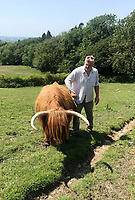 BNPS.co.uk (01202) 558833. <br /> Pic: RedlandCoppice/BNPS<br /> <br /> Farmer, Cameron Farquharson with the Gladis the cow who is no longer with us. <br /> <br /> A farmer whose beloved Highland cow was chased to its death by two pet dogs has been given nine more by a kind stranger.  <br /> <br /> Gladis, a 'beautiful' rare breed, broke her neck and died two months ago along with the unborn calf she was about to give birth to after tumbling 40ft down a steep embankment.<br /> <br /> She was running from two Labradors that had been let off their leads on Eggardon Hill near Bridport, Dorset.