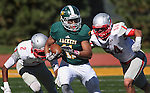SPEARFISH, SD - OCTOBER 10, 2015 -- Bradley Adamson #11 of Black Hills State tries to elude defenders Isaiah Jackson #2 and Jack Millard #54 of Western State Colorado during their college football game Saturday at Lyle Hare Stadium in Spearfish, S.D. (Photo by Dick Carlson/Inertia)