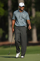 PONTE VEDRA BEACH, FL - MAY 5: Tiger Woods smiles as he walks on the green of the par 3 8th hole during Tiger's practice round on Tuesday, May 5, 2009 for the Players Championship, beginning on Thursday, at TPC Sawgrass in Ponte Vedra Beach, Florida.