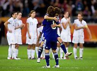 Mizuho Sakaguchi, Aya Miyama.  Japan won the FIFA Women's World Cup on penalty kicks after tying the United States, 2-2, in extra time at FIFA Women's World Cup Stadium in Frankfurt Germany.