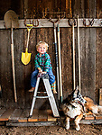 Denim sitting on the ladder, happy to have hung his shovel next to grandpa's