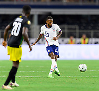 DALLAS, TX - JULY 25: Kellyn Acosta #23 of the United States passes the ball to a teammate during a game between Jamaica and USMNT at AT&T Stadium on July 25, 2021 in Dallas, Texas.
